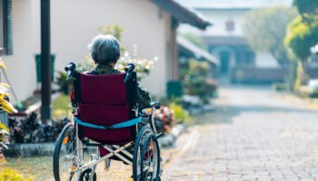 DRT and Paratransit: Woman in a wheelchair is waiting.